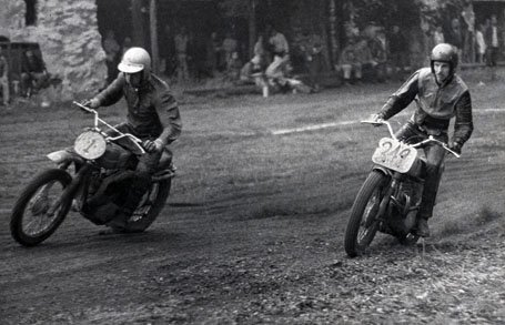 This is an image of 2 riders dueling it out in a dirt bike race