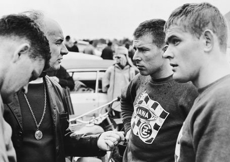 4 male riders chatting with each other, (from left) Dave Bickers, Roger DeCoster and Joel Robert