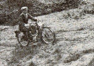 Motocross man riding through a field