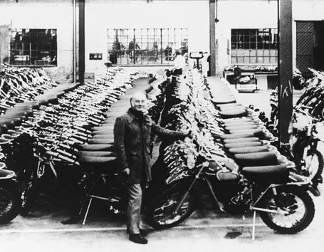Edison Dye at the Husky Factory standing by thousands of MX bikes
