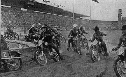 This is an image of a Group of racers on the track racing during the Prague supercross circa 1956
