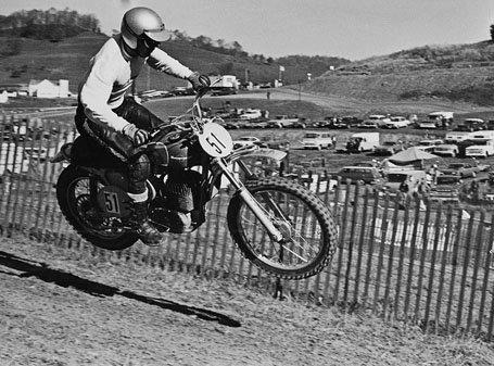 Torsten Hallmen taking a big jump on his motocross bike in a race